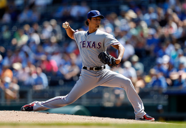 Yu Darvish #11 of the Texas Rangers pitches during the 1st inning of the game against the Kansas City Royals at Kauffman Stadium on September 3, 2012 in Kansas City, Missouri. (Sept. 2, 2012 - Source: Jamie Squire/Getty Images North America)