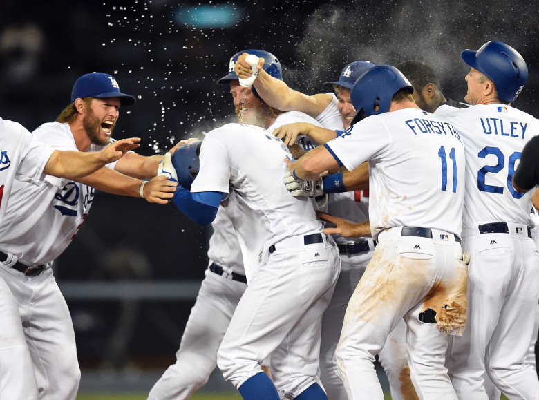 Los Angeles Dodgers celebrate Chris Taylor's (3) walk off single in the bottom of the ninth inning during their game against the Arizona Diamondbacks at Dodger Stadium in Los Angeles, Thursday, July 6, 2017. The Dodgers beat the Diamondbacks 5-4. (Photo by Hans Gutknecht, Los Angeles Daily News/SCNG)