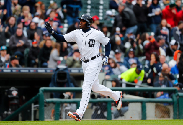 Detroit Tigers' Justin Upton celebrates hitting a two-run home run against the Minnesota Twins in the sixth inning of a baseball game in Detroit, Thursday, April 13, 2017. (AP Photo/Paul Sancya)