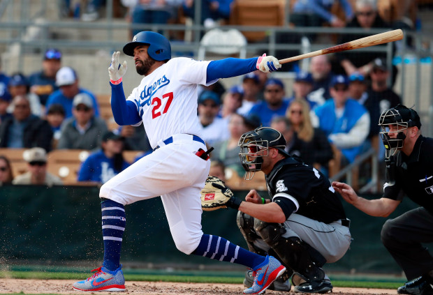 Los Angeles Dodgers' Matt Kemp connects for a home run during a baseball spring exhibition game against the Chicago White Sox, Friday, Feb. 23, 2018, in Glendale, Ariz. (AP Photo/Carlos Osorio)